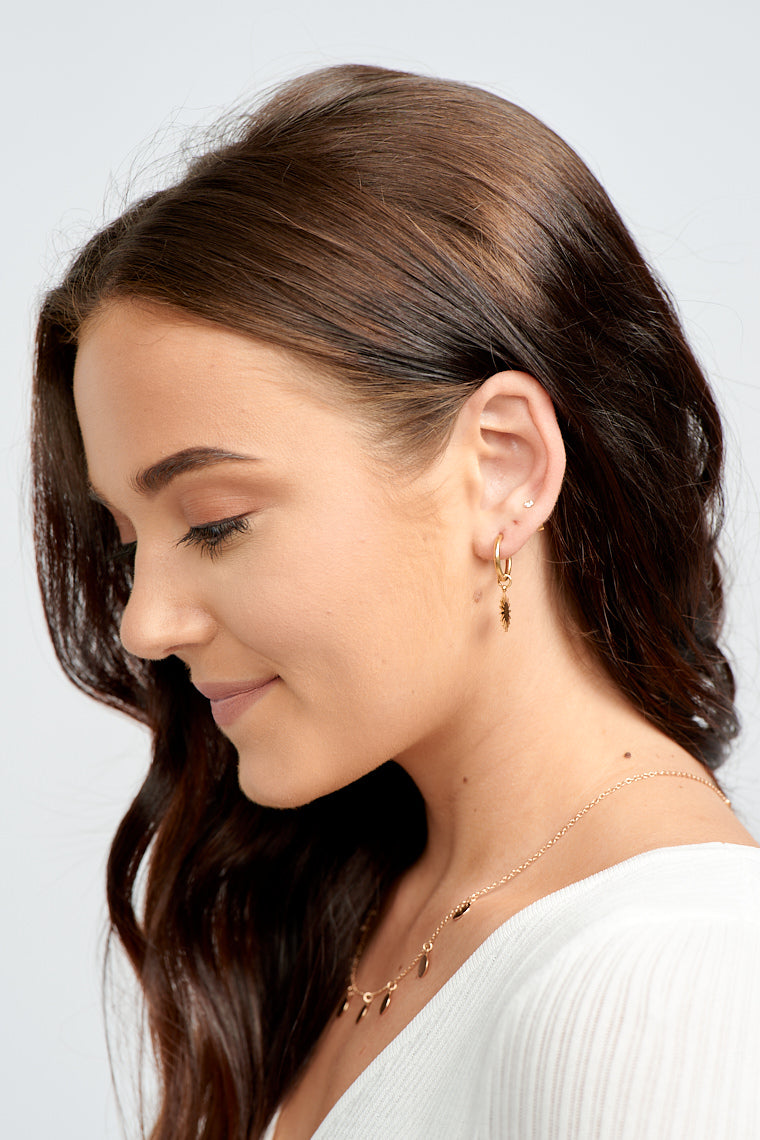 Add some shine to your look with the Carla Sunburst Huggy Earrings!