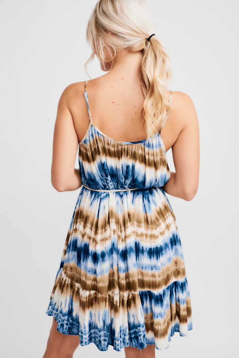 Shades of blue and brown, this dress has skinny straps on a straight neckline, a relaxed bodice, and oversized silhouette that can be defined with the rope belt.