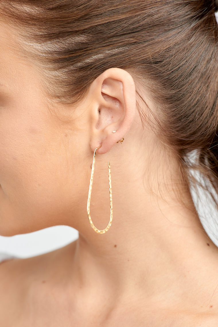 These lightweight earrings have a post that attaches to a hammer-textured wire that drops down to a long u-shape.