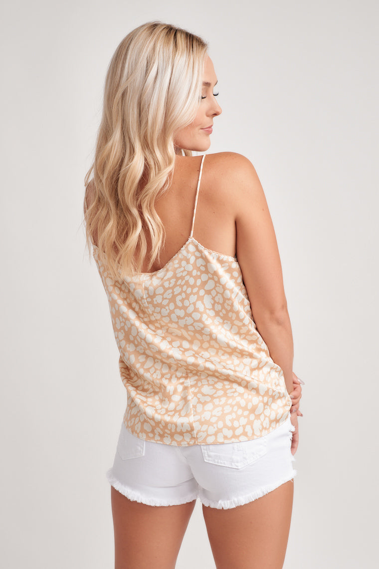Splendid silky-smooth fabric with a blush and cream leopard print! Skinny straps support a relaxed bodice with a low cut back and wide-cut silhouette.
