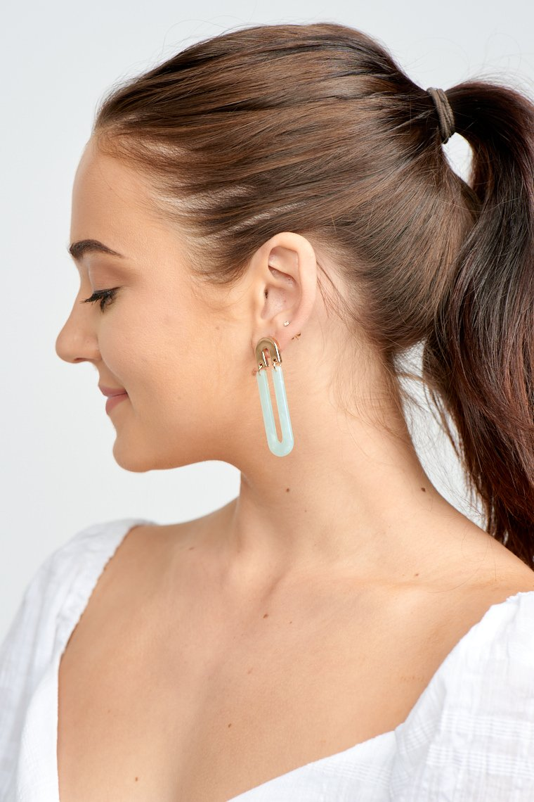 These lightweight earrings have a post that is attached to a small inverted u-shape and leads down to an extended aqua u-shaped drop.