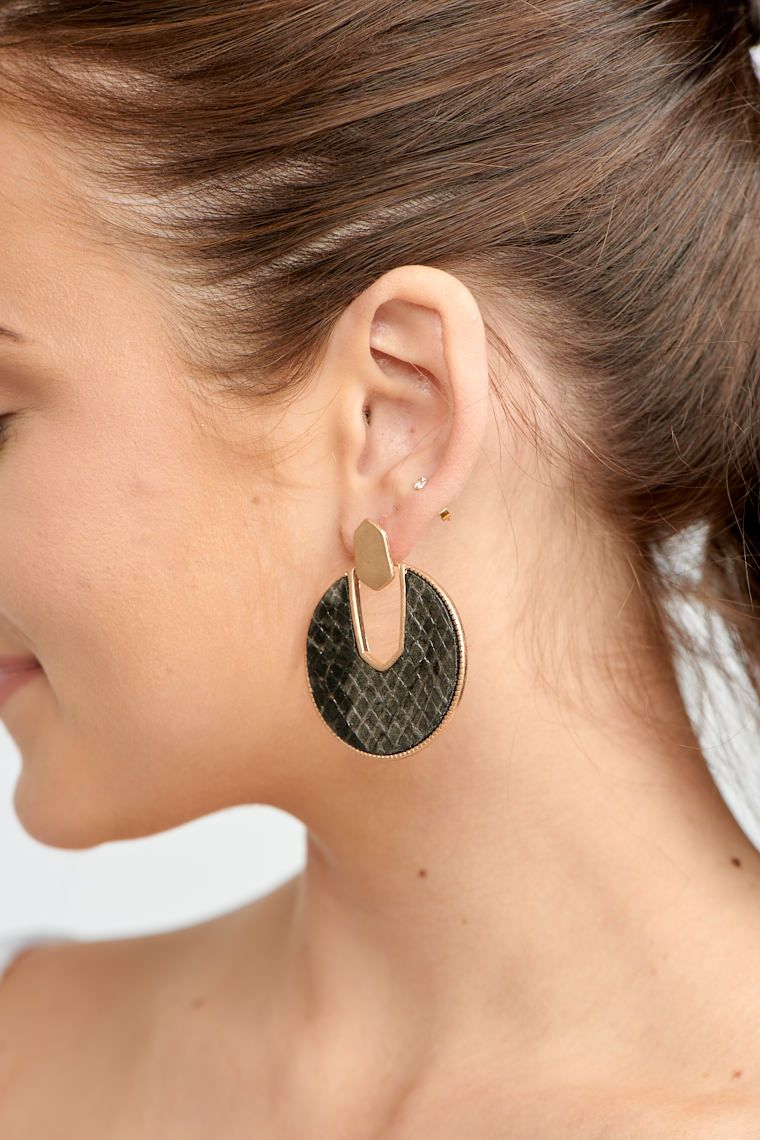 These stunning earrings have post attached to a geometric piece and then drops down to a cut-out circular reptile print piece.