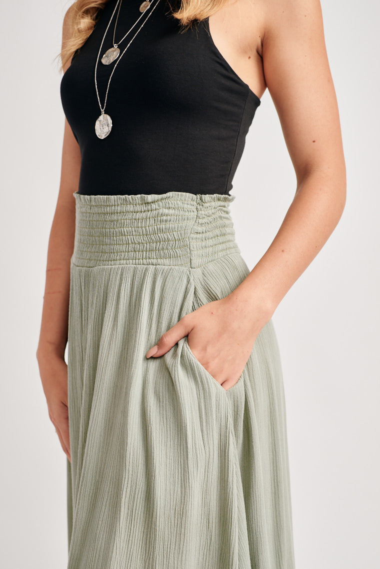 Ultra-lightweight and breezy fabric forms this flowy, handkerchief midi skirt, perfect for those hot summer days. The smocked waistline offers a high-rise fit.