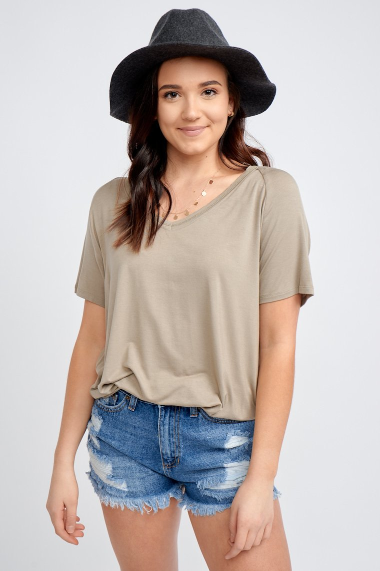 This lightweight tee has short sleeves that attach to a banded v-neckline and lead down to a relaxed and oversized bodice silhouette.