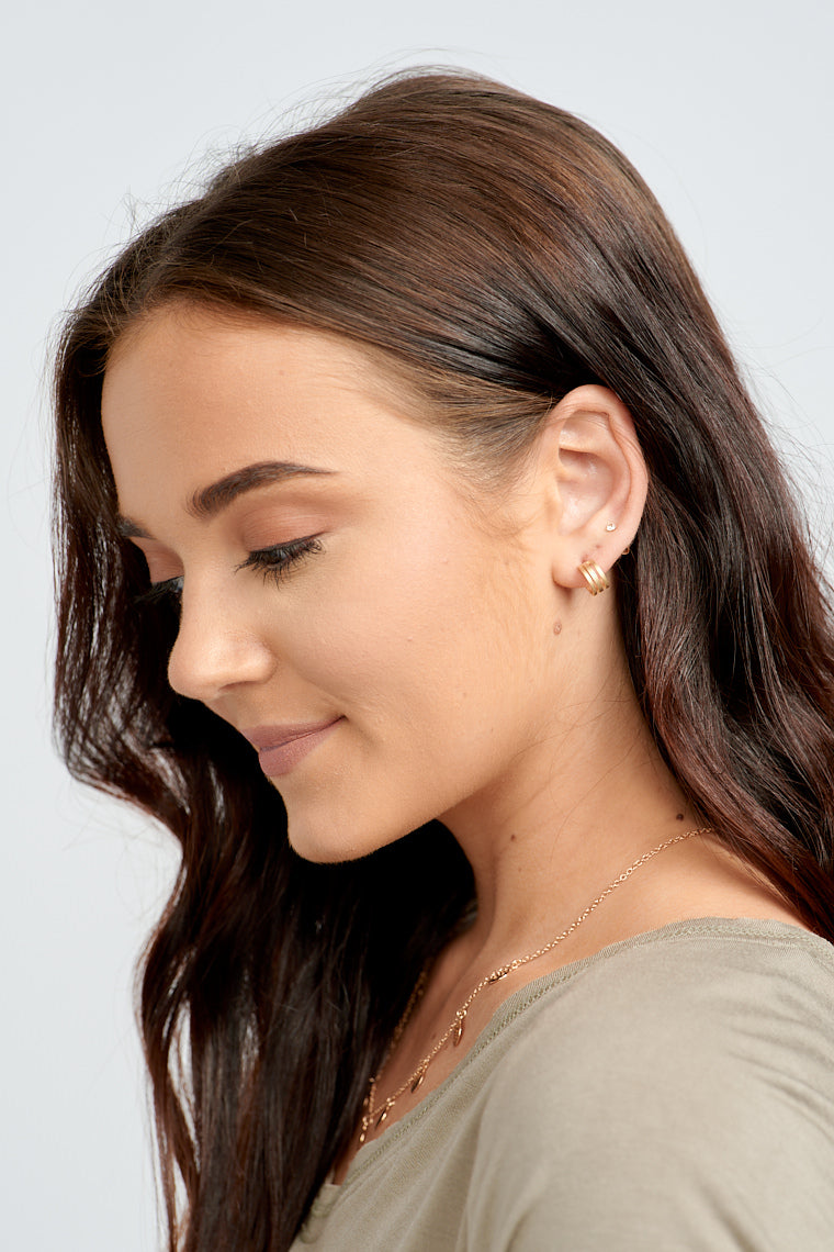 Add a simple stack of modern jewelry to your ears with the Kally Gold Huggy Earrings!