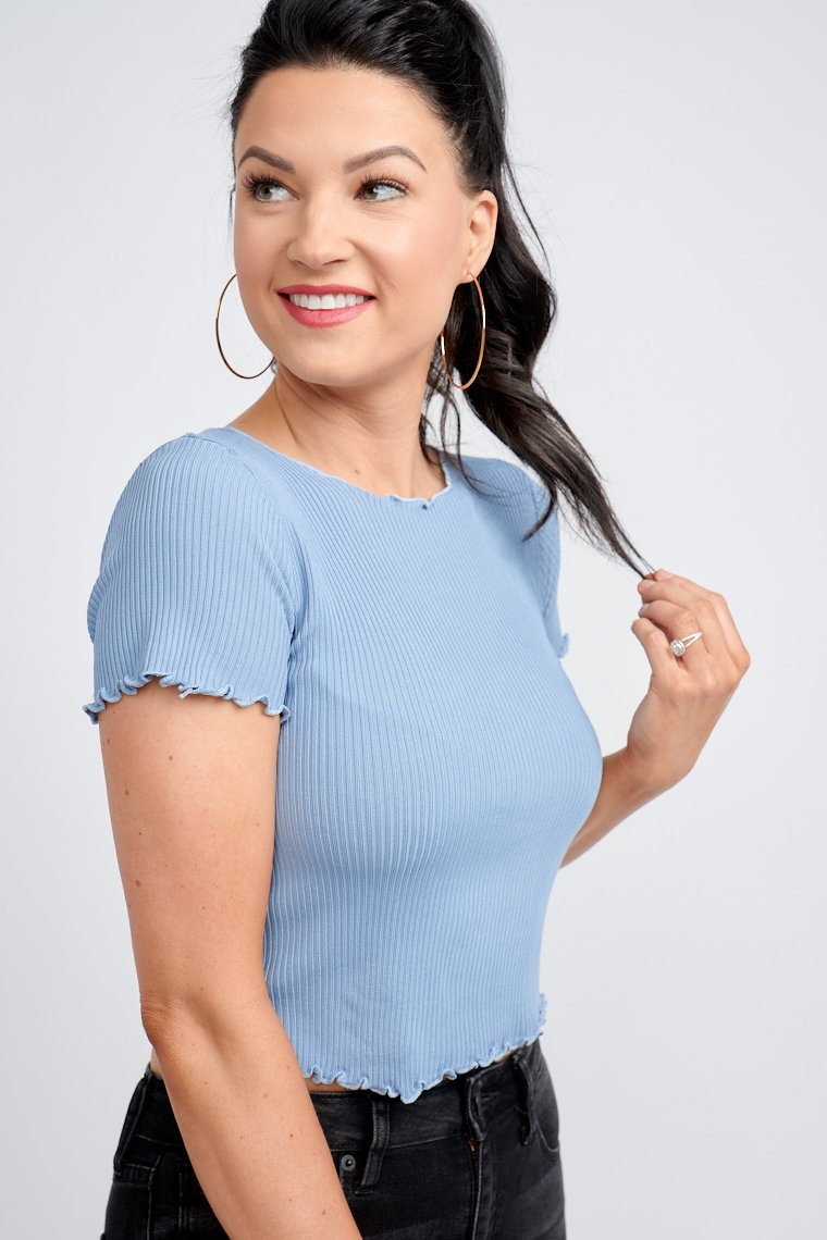 "This top has lettuce trimmed short sleeves that attach to lettuce trim u-neckline and lead down ""free size"" ribbed bodice that stretches to the curves of your body."