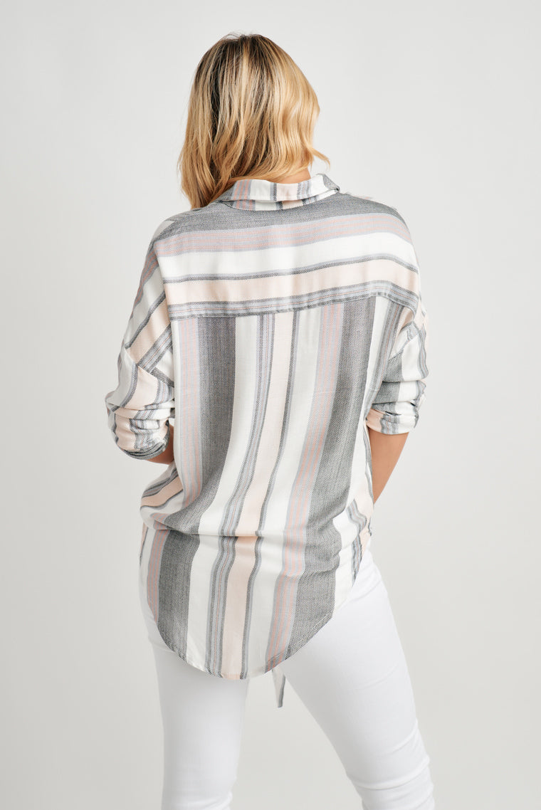 Stripe blouse features a relaxed, button-down silhouette with a tie front feature and finishes with long, roll-up sleeves with a button tab.