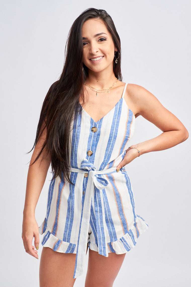 Blue stripes go down this lightweight linen romper. Thin adjustable straps attach to a v-neckline on a button-down and relaxed bodice and lead down to shorts with a ruffle hem.