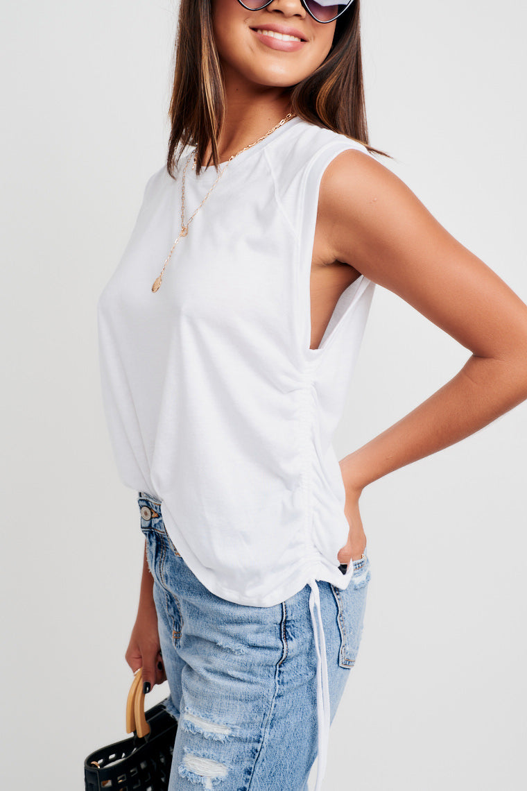 This high neckline top has an oversized silhouette bodice and adjustable drawstrings at the side to customize the look. Pair with jeans and sandals!