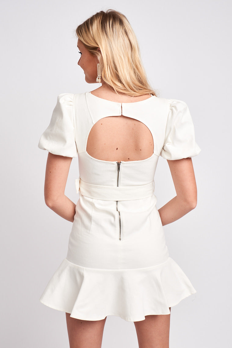 Short elastic puff sleeves attach to a boned split neckline on a darted and fitted bodice silhouette meeting hip-hugging fitted mini pencil skirt with a circle ruffle hem.