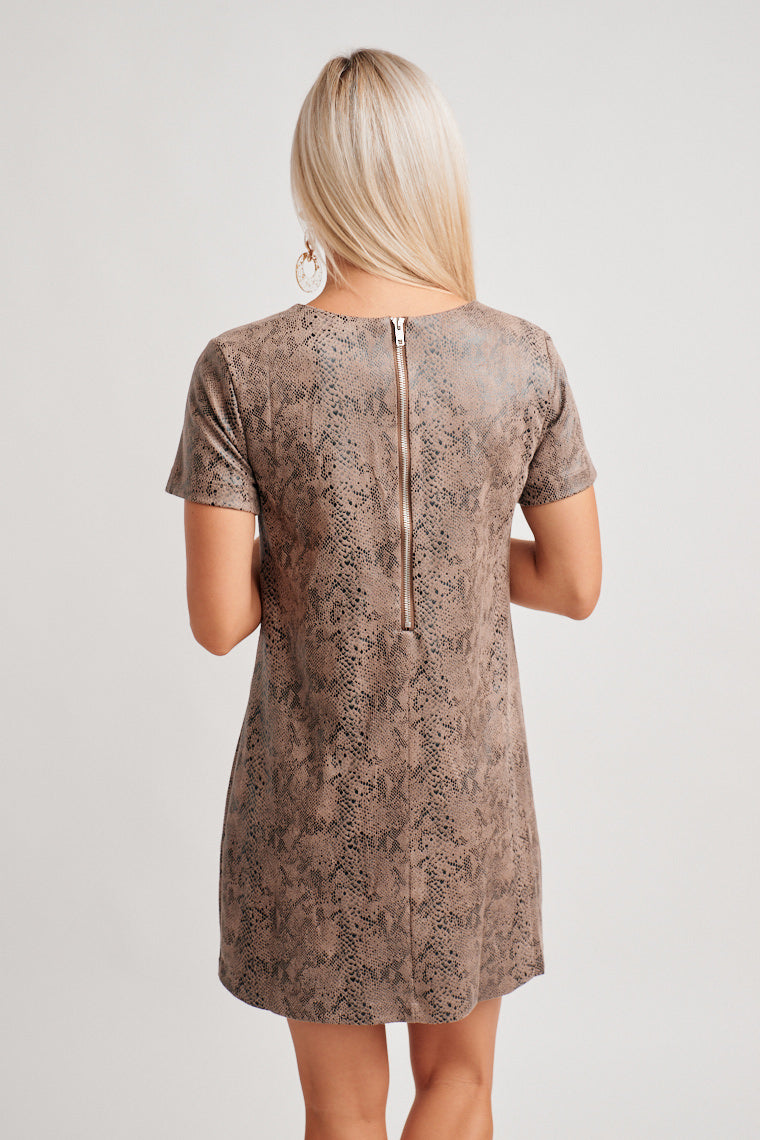 This gently reptile printed dress has short sleeves that attach to a banded u-neckline and leads to a darted and relaxed shift dress silhouette.