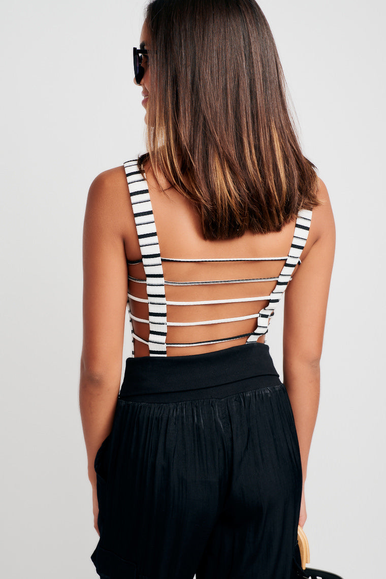 This black and white striped and ribbed bodysuit has medium straps that attach onto a straight neckline and fitted bodice, has a cut-out exposed back look.