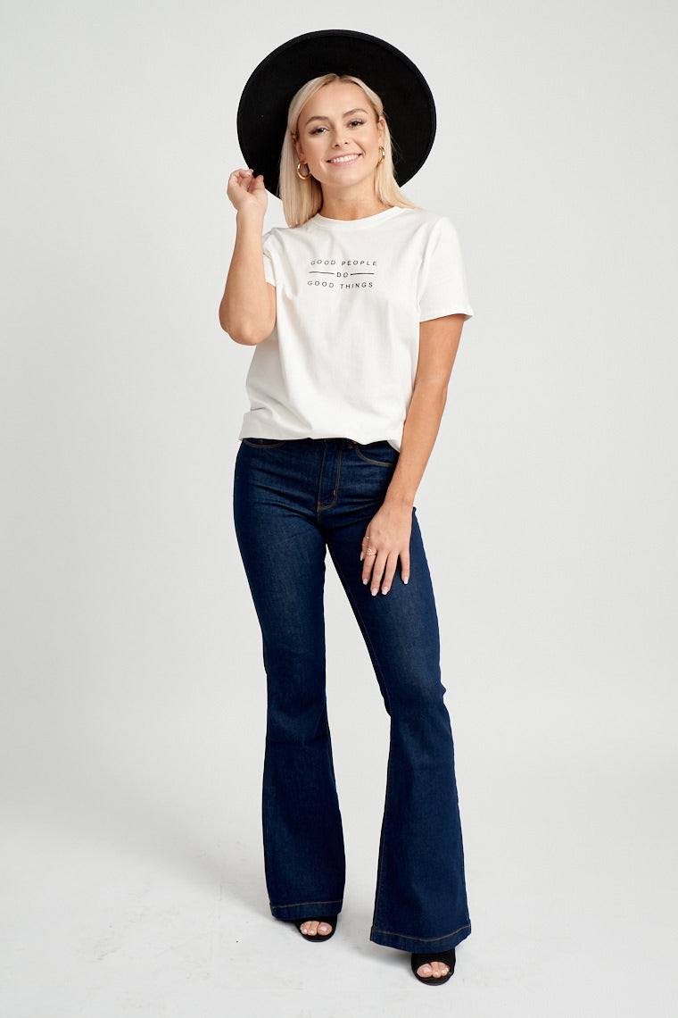 "This white t-shirt has short sleeves that attach to a u-neckline on a relaxed and comfortable bodice. The text ""Good people do go things"" is centered at the center."