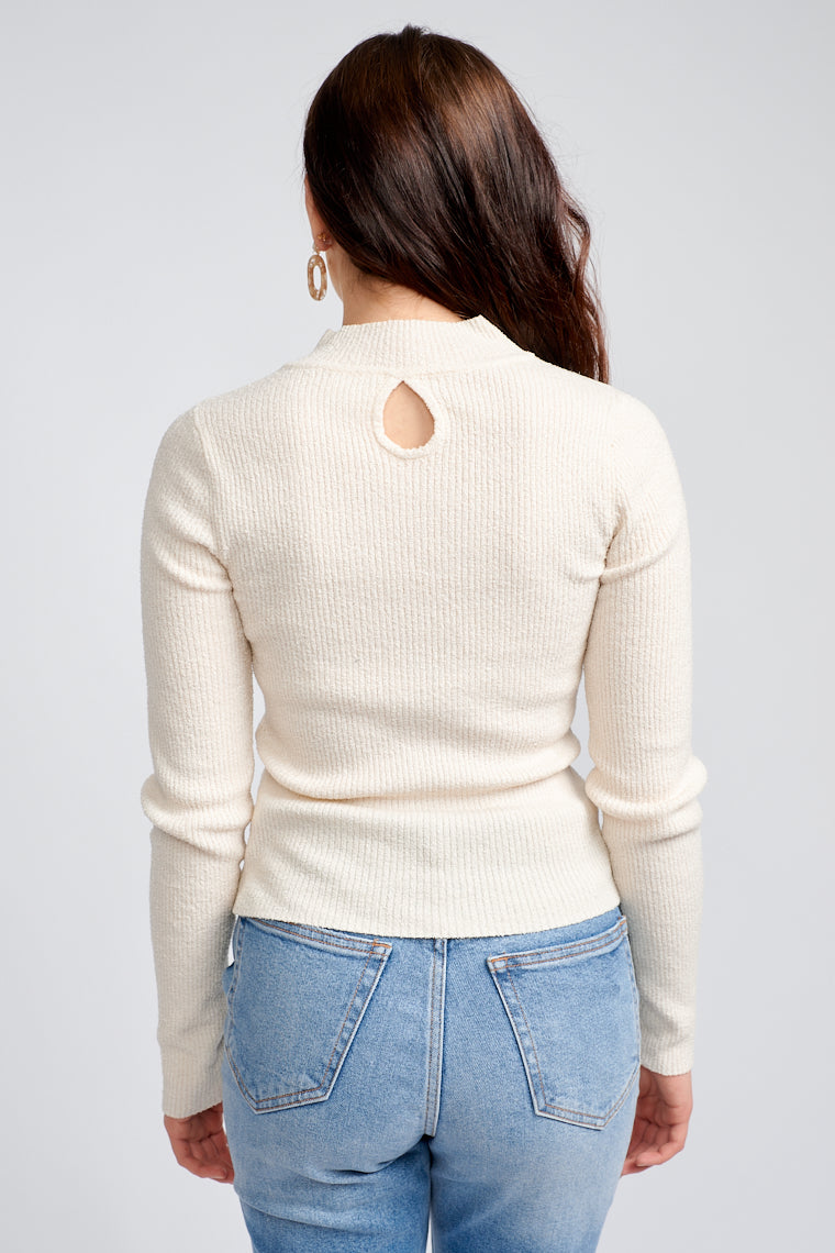 This cozy sweater has long sleeves that attach to a mock neckline and lead down to a fitted yet comfortable bodice silhouette that meets at the lower waist.