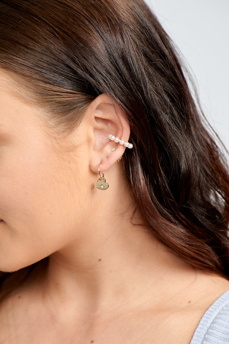 Love your look by adding the Sola Heart Huggy Earrings to your first or second earhole!