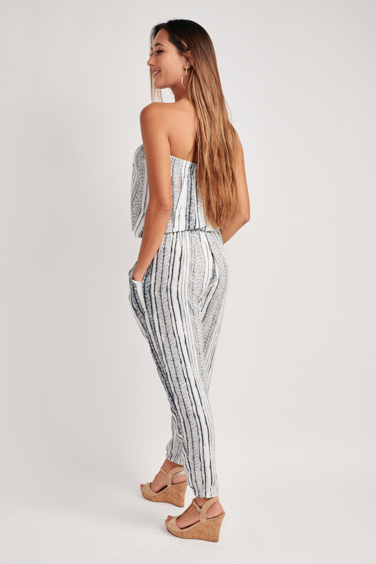 This elasticized, strapless neckline flows into a billowing bodice and an elasticized, drawstring waistline. The straight pant leg offers a nice flowy feel.