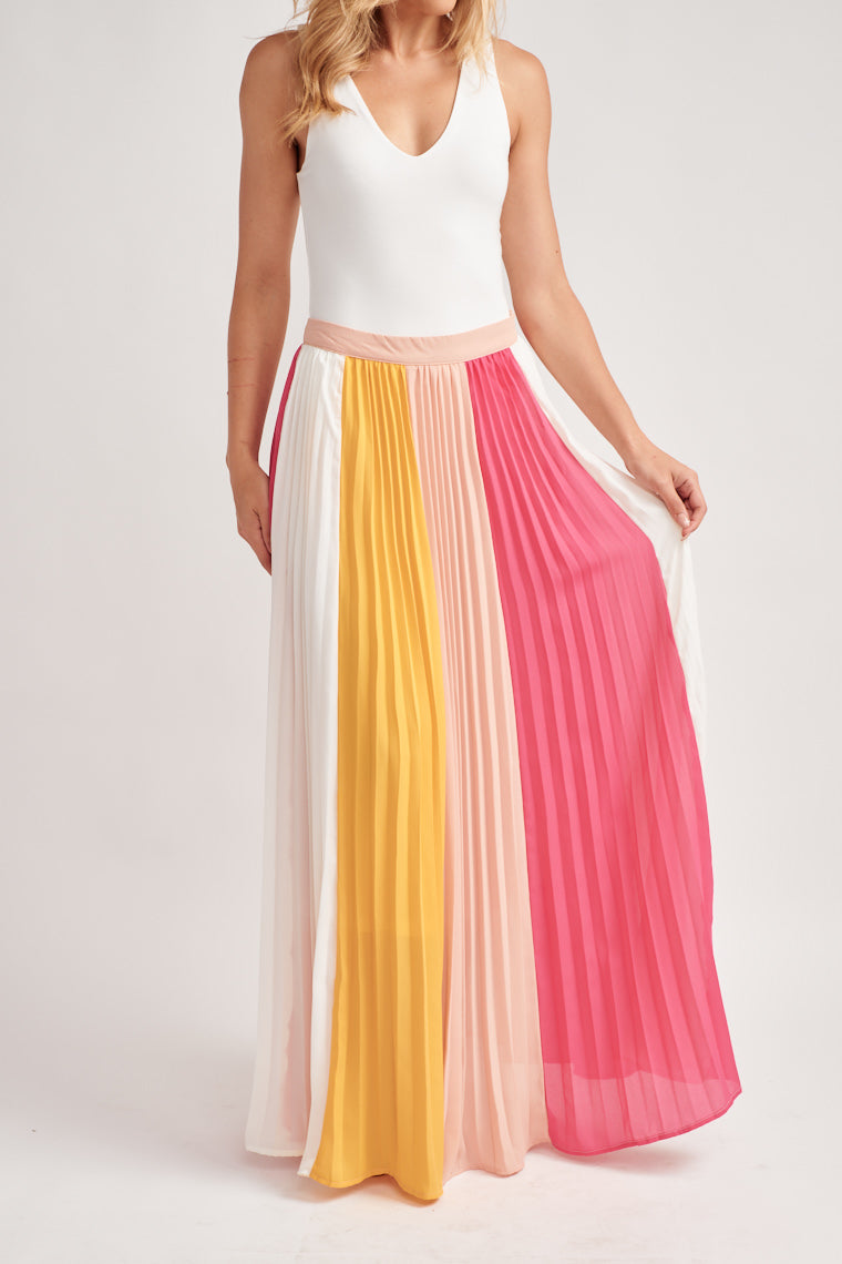 This gorgeous yellow, pink and white shades create a color-block look on this accordion pleated maxi skirt. The banded, fitted waistline hugs your waistline perfectly.