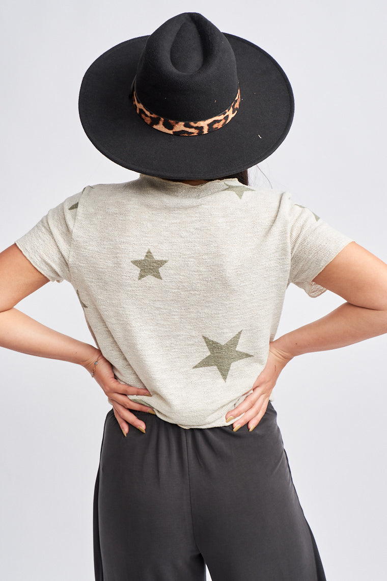 This low-gauge and lightweight tee has large olive stars that go across its fabric. Short sleeves attach to a v-neckline on a loose and comfortable bodice silhouette.