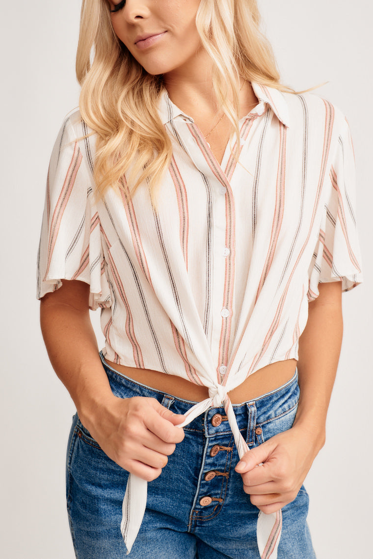 This collared top has black and red striped on lightweight, short sleeves, and buttons down the bodice that leads to a tie-front hem. Style with boyfriend jeans!