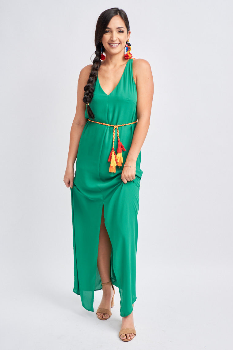 Medium straps attach to a deep v-neckline on a paneled bodice down to a long straight maxi skirt with a split down the middle. Colorful braided cords criss-cross on the back of the dress.
