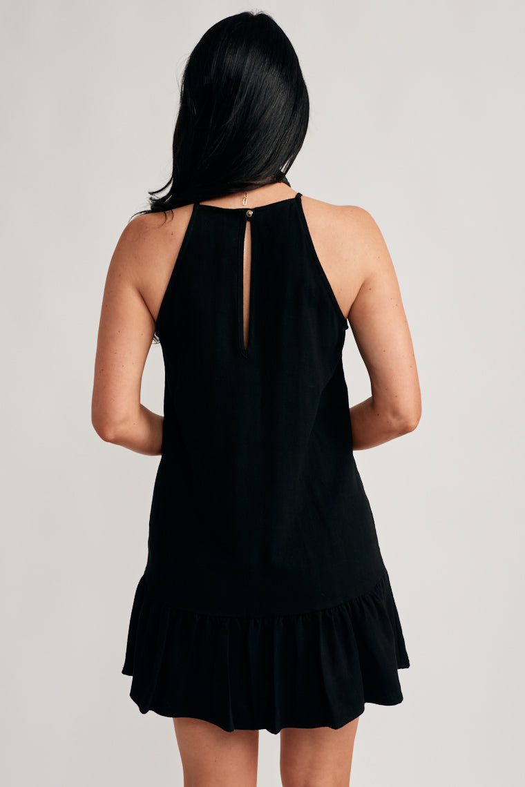 090dc811eab ... A classy black hue forms a high neckline with a button back closure on  this sleeveless ...