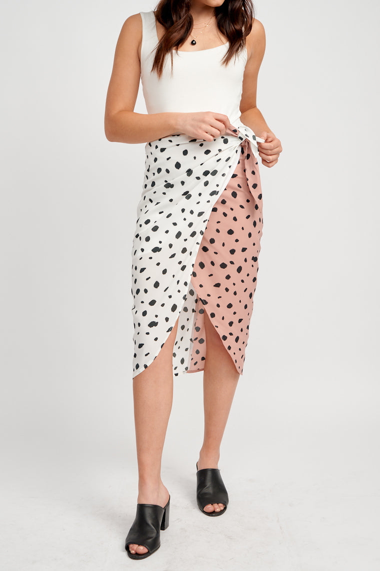 Fabric tie adjusted waistband that wraps at the waist and flows down to a skirt panel that drapes into a tulip style silhouette which reaches the mid-calf.