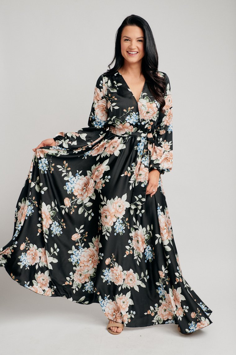 Long elastic cuff sleeves attach to a surplice neckline on a relaxed bodice and lead to an elastic waistband and flow down into a full maxi skirt silhouette.