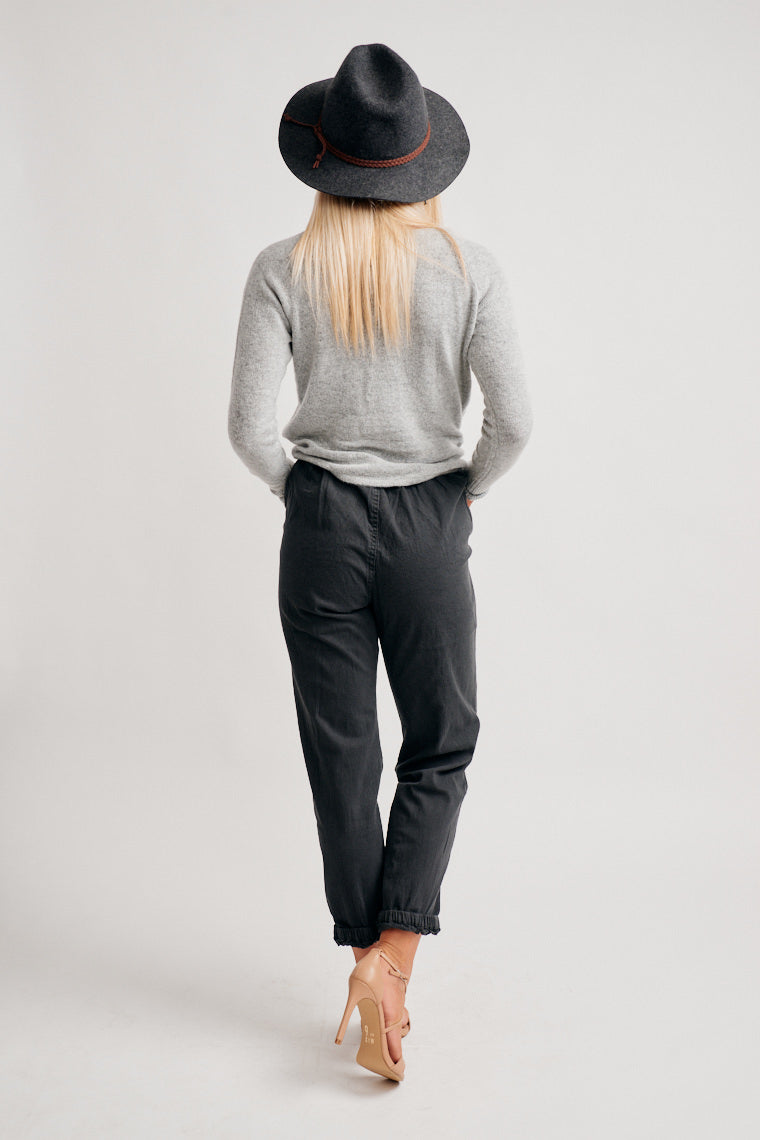These joggers have a button and zipper closure at the front and lead to square pockets at the side and go down to a relaxed fit and elastic cuffed pant legs.