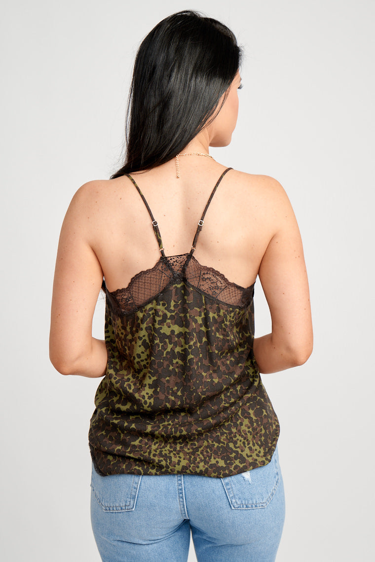 Brown and black prints speckle, thin adjustable straps attach to a lace-trimmed v-neckline and lead to a relaxed fit bodice silhouette with small lace trim at the bottom.