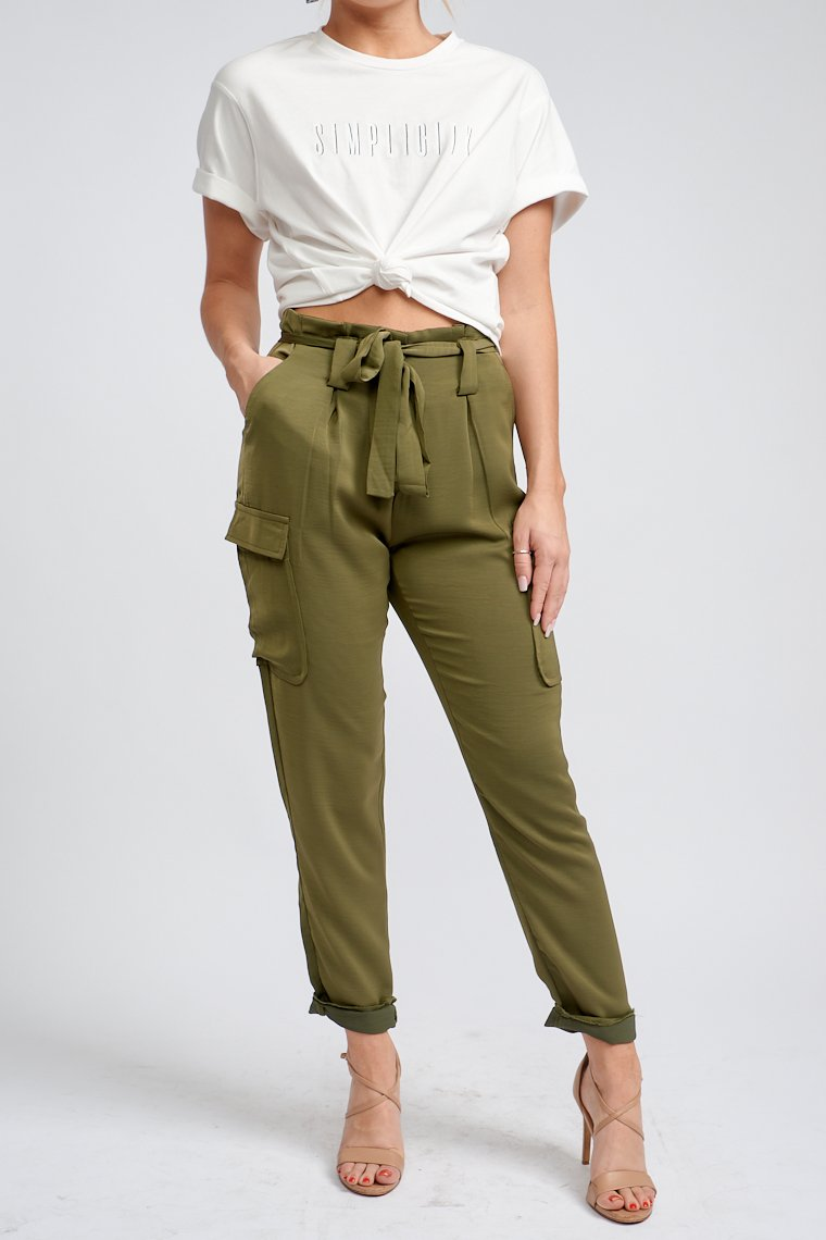 High paper bag style waist that leads to belt loops, fitted waist with some pleat details to side pockets, a large flapped pocket goes down to straight pant legs.