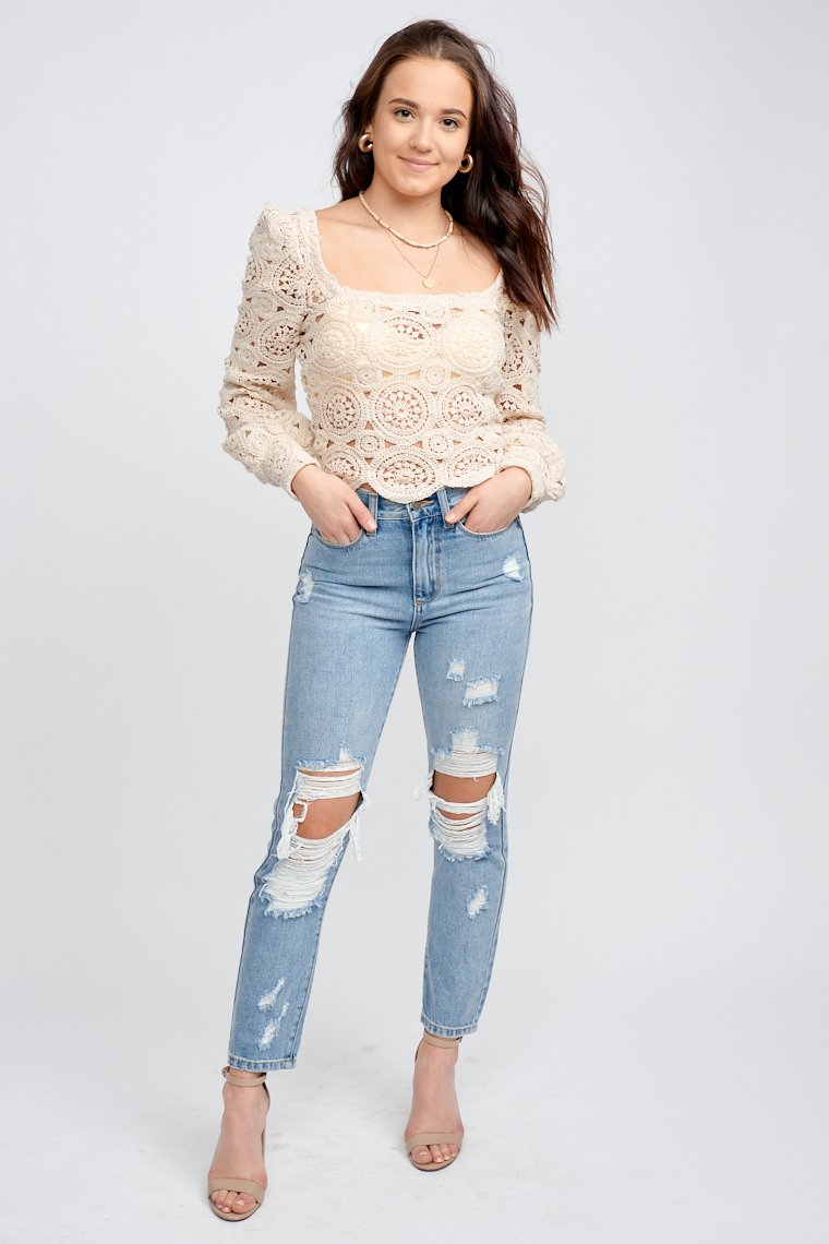This darling cropped crochet top long banded puff sleeves that attach to a square neckline on a relaxed fit bodice with a scalloped hem.