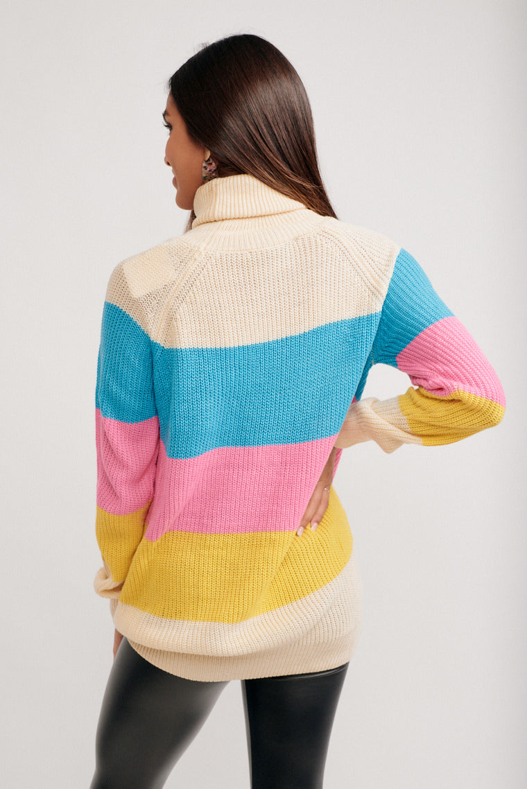 Multi-color rainbow stripes across its bodice. It has long sleeves that attach to a turtle-neckline and leads down to an oversized bodice that meets a banded hemline.