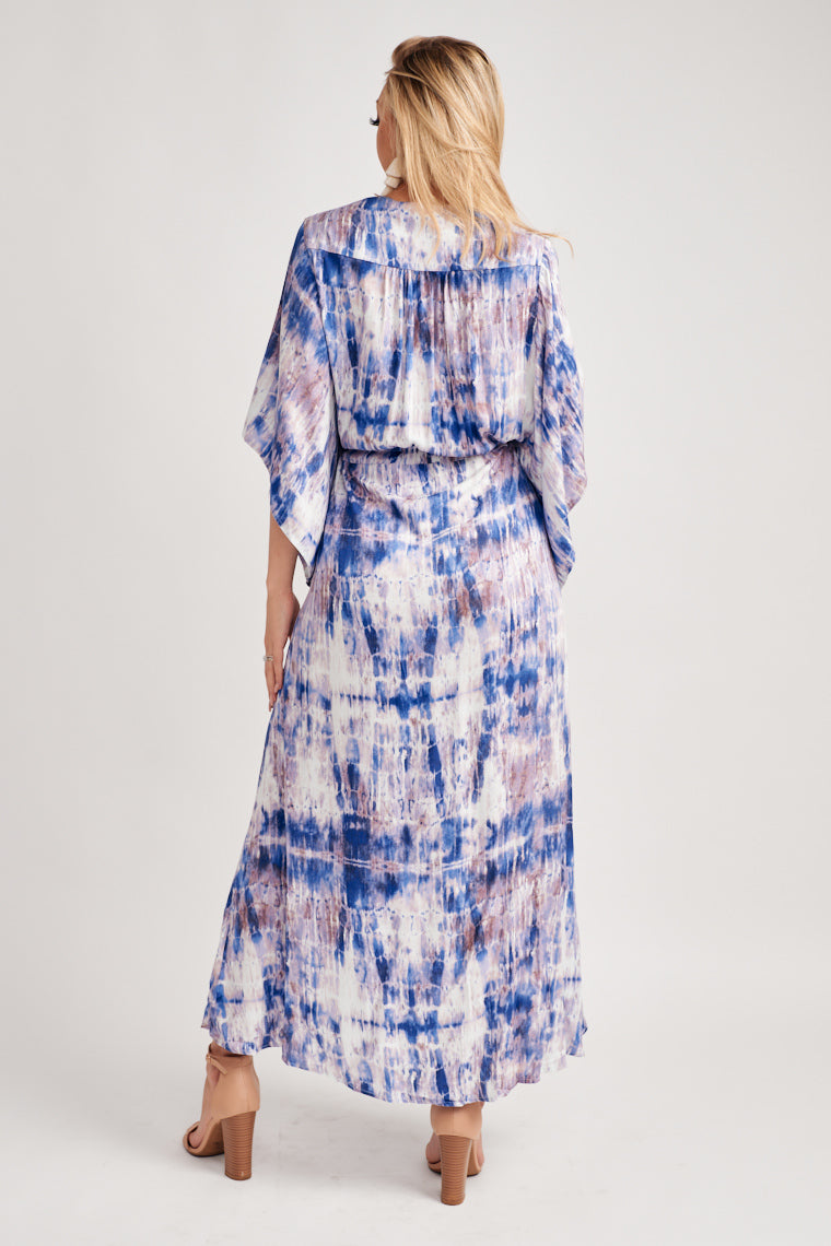 Shades of purple and off-white tie dye decorate this gorgeous summer maxi dress. Starts off with kimono sleeves and a v-neckline with a button-down center.