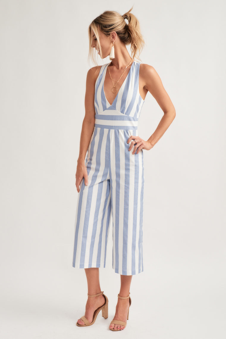 Blue and white stripes move down the plunging, halter neckline with an ascending point bodice, and a T cut out back, with a wide cut, cropped pant leg.