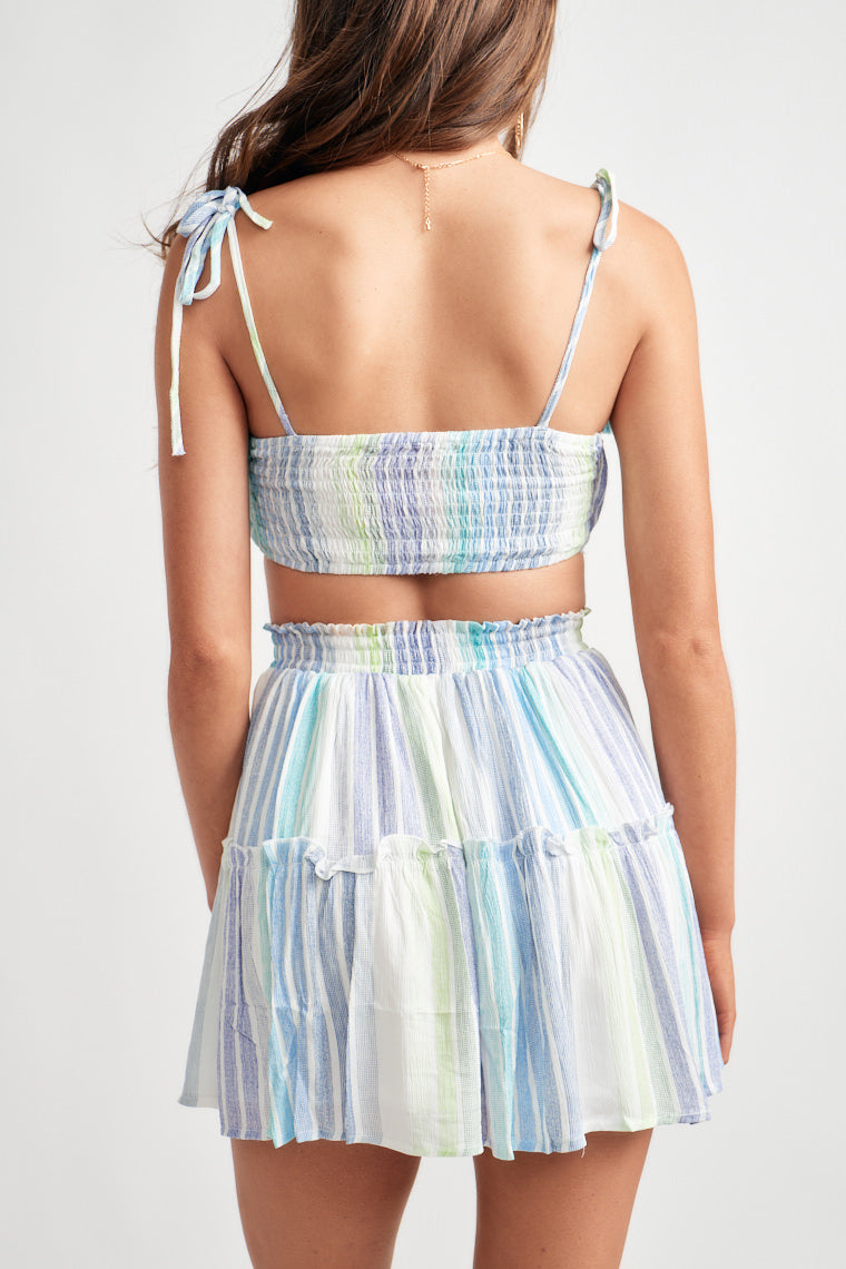 Vibrant hues of yellow and blue create the stripe print on this flirty, flowy skater skirt with an elasticized waistline and ruffle details as an accent.
