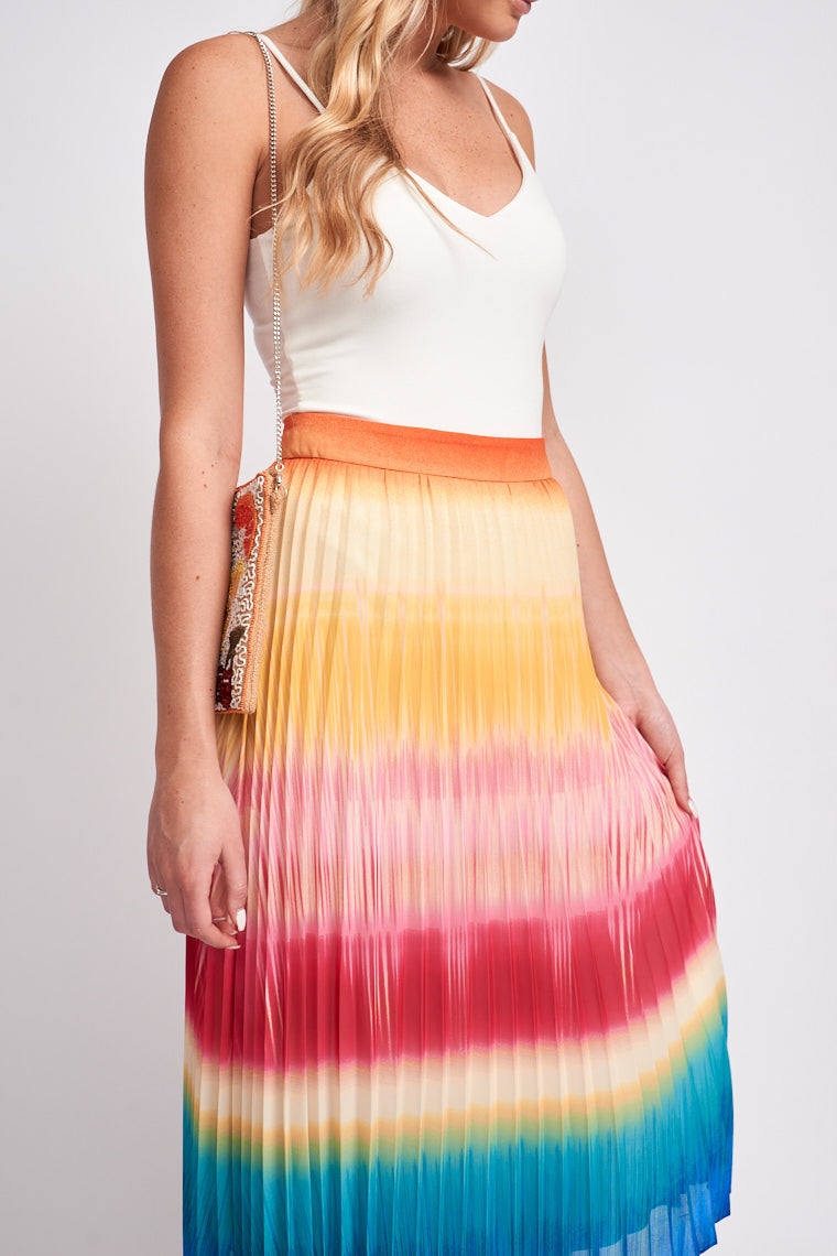 Colors of the rainbow go down in an ombre effect on the fabric. It has a fitted banded waist and leads to a pleated a-line silhouette that meets at the mid-calf.
