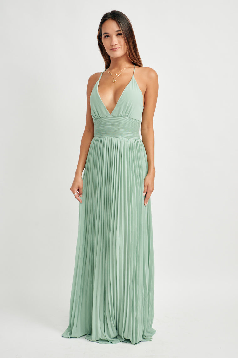 This seafoam green maxi dress has skinny straps cross at the back and adjust for a custom fit on the plunging triangle neckline, with a gathered bodice.