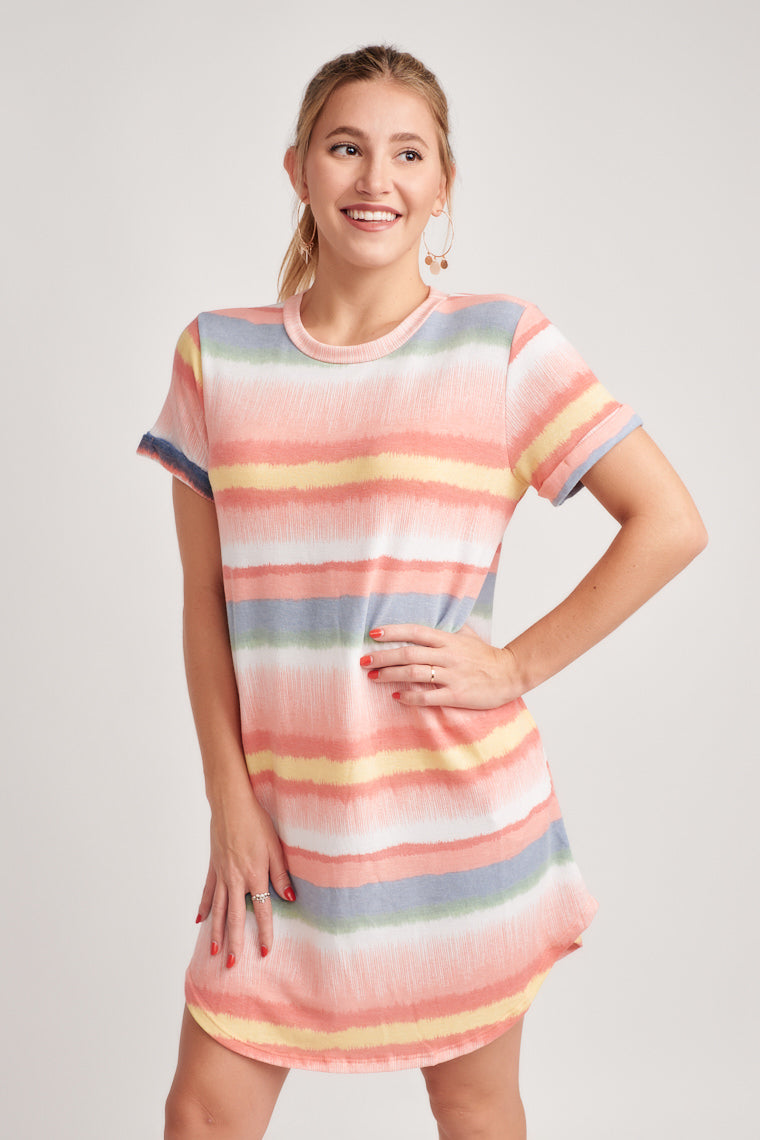 This uniquely printed dress is shaped by a lightweight and comfortable fabric to form the rounded neckline, short sleeves and t-shirt style silhouette.