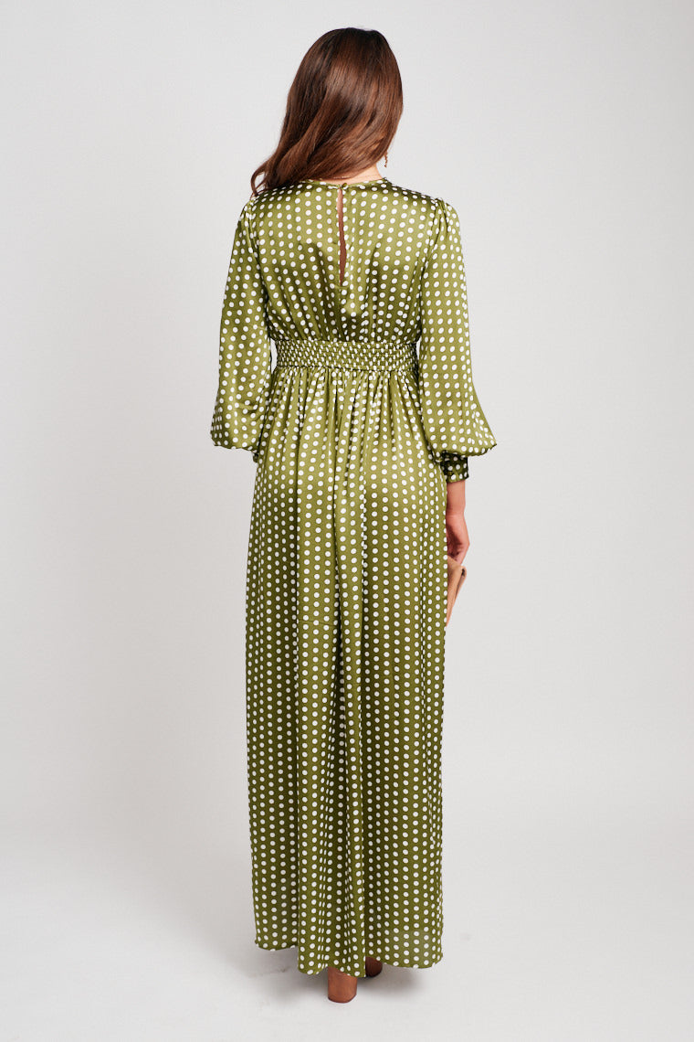 This long-sleeved button cuffed dress has a deep v-neckline that leads to a banded fitted waistband and leads to a long and flowy maxi skirt.