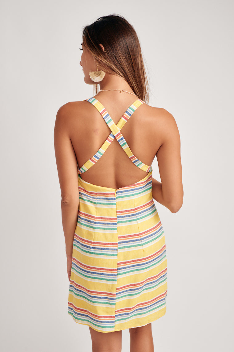 This yellow dress features rainbow stripes to bring brightens to your style. Thick straps cross and crew neckline with a darted bodice and straight fit silhouette.