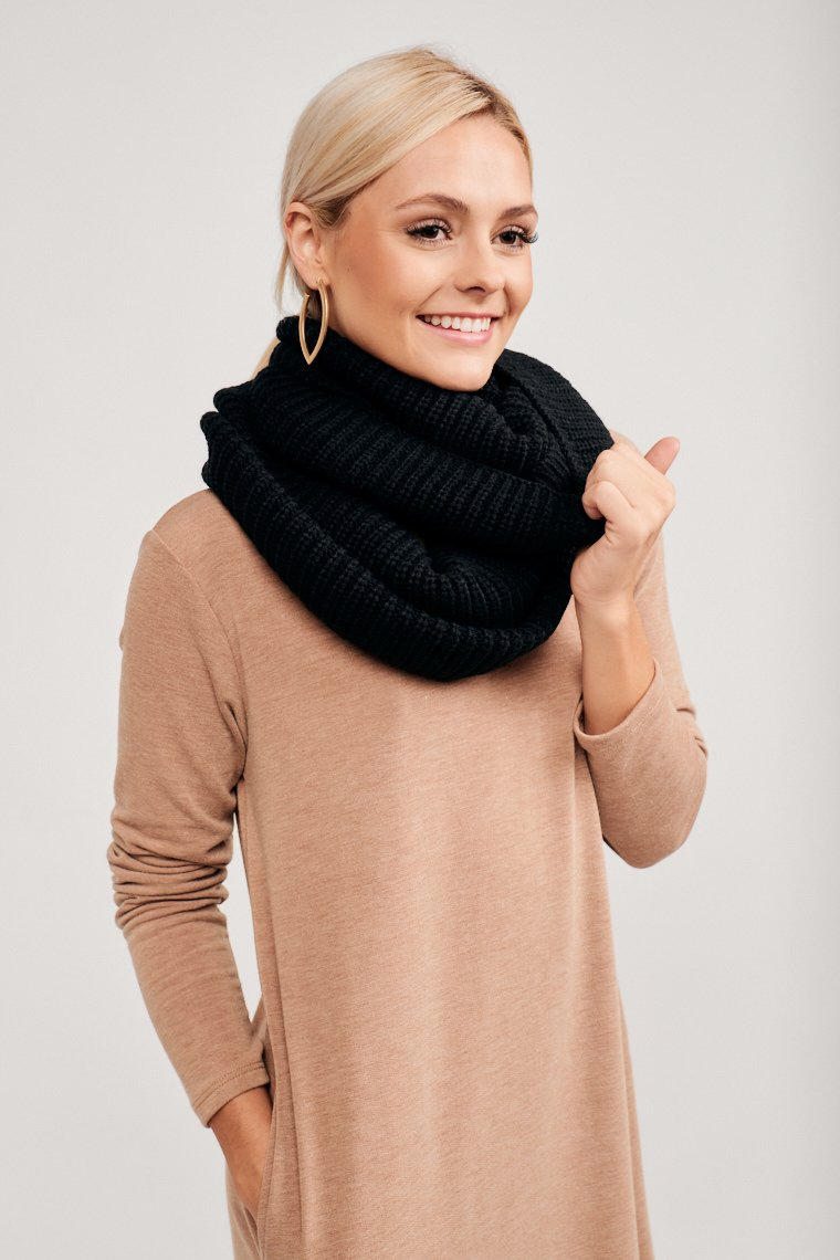 This thick knit scarf is circular and can be wound high up your neck so that you can beat the chilly weather. It's perfect to throw atop your cold-weather outfit and go!