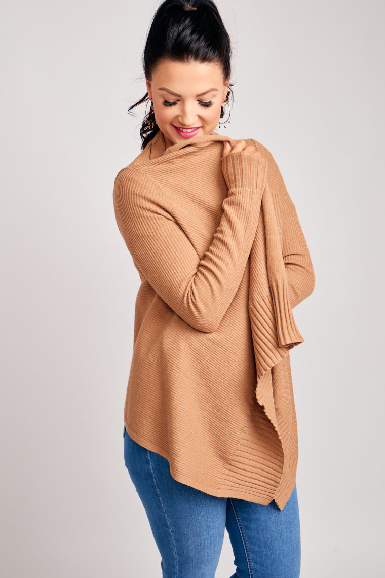 This cardigan has long knitted and ribbed sleeves that attach to a comfortable and oversized open cardigan. Throw it atop of your tee and jeans.