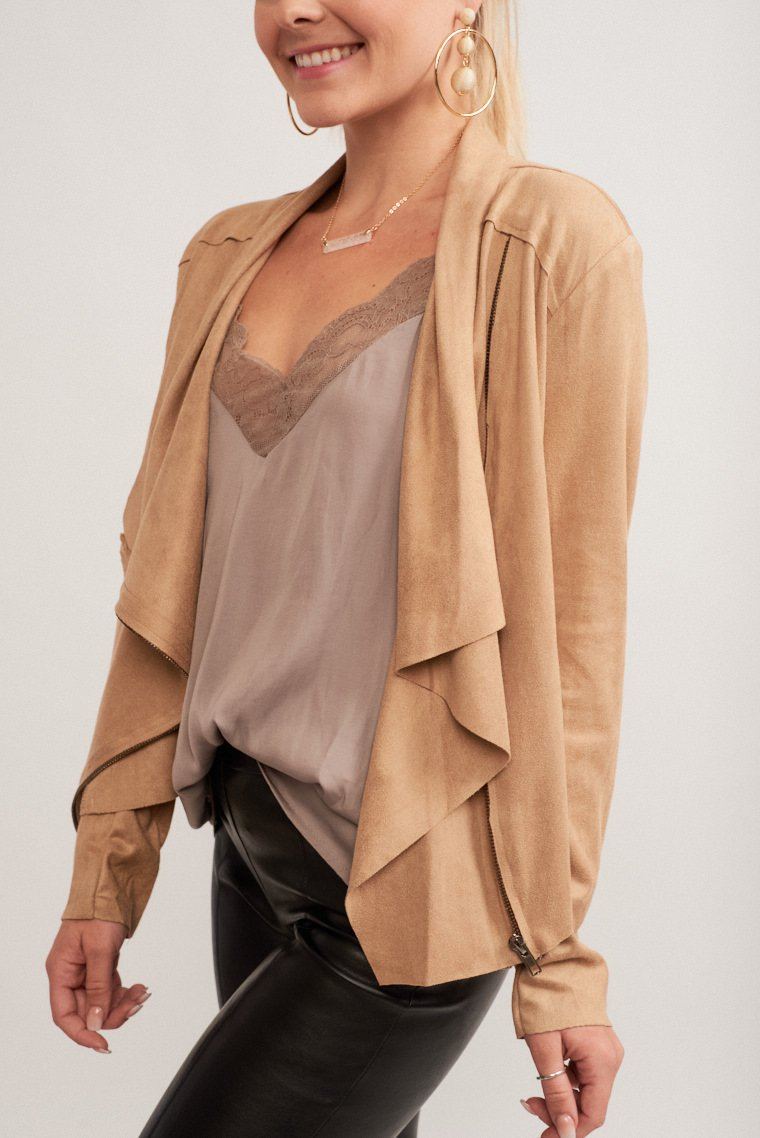 Long sleeves that attach to an open neckline and with panels that drape down. Zipped off-center and one panel is covered and has a relaxed fit bodice.