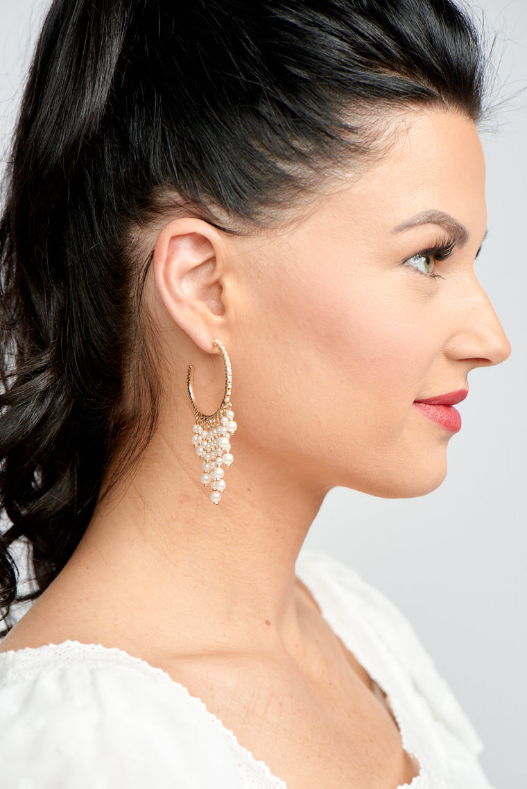The McKenna Pearl Drop Tassel Hoops will add a touch of chic sophistication to your look!
