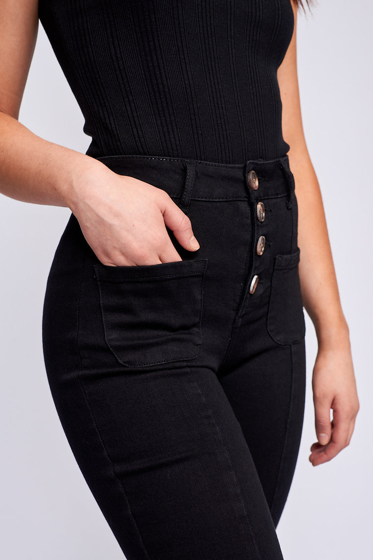 Fitted waistband with a tortoise button-down fly and hug your waist as they lead down to two front-facing pockets and bell-bottom leg with a seam detail from waist to bottom hem.