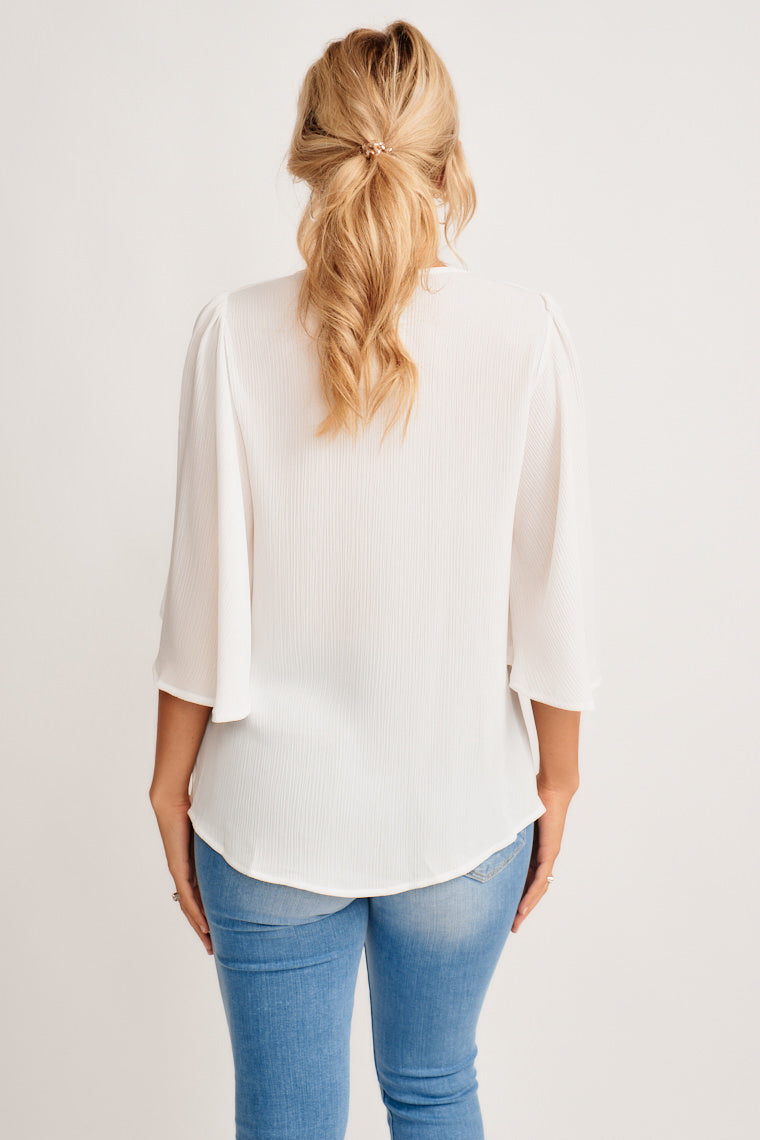 This blouse is exactly what you need to get through your busy week! This simple yet sophisticated blouse features a v-neckline with a relaxed silhouette and short flutter sleeves.
