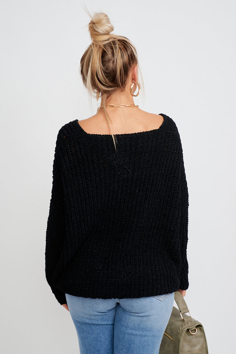 This cozy and soft sweater has long sleeves that attach to a wide v-neckline and leads down to an oversized and relaxed bodice silhouette that meets at the upper thigh.