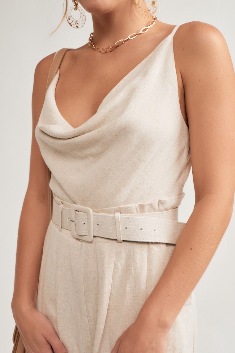 Skinny straps supporting a cowl neckline with a relaxed bodice, paper bag, pleated shorts folded at the hem and a belt feature around the waist.