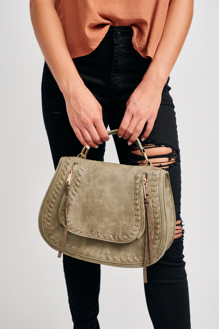 The Rowan Satchel is here to hold all of your daily knick-knacks in the most stylish way! This medium sized bag perfect to zip up and go!