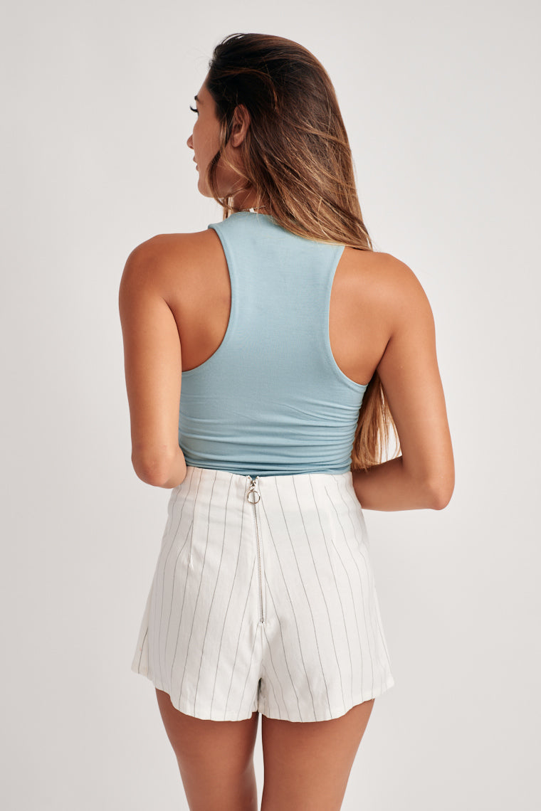 Ultra-soft, stretch knit shapes this high neckline with a double lined, fitted bodice. Complete with high rise bell bottoms, skirts or shorts for an effortless ensemble!